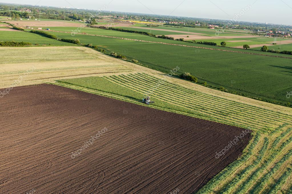 aerial view of harvest fields with combine