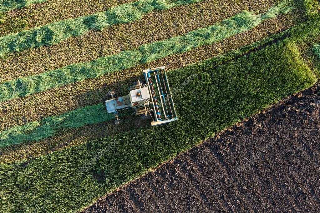 aerial view of harvest fields with old combine