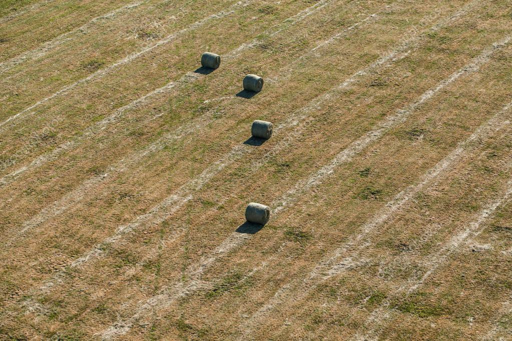 aerial view of hay bales on harvest field