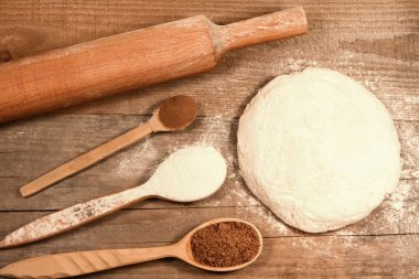 homemade baking. Fresh dough for pastry, kitchen rolling pin, spoon flour on a chopping Board