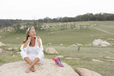 Happy relaxed woman outdoor with high heels