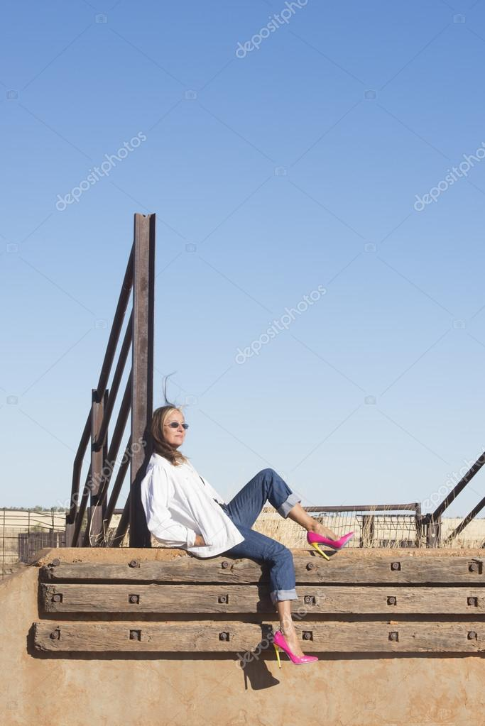 Relaxed woman in high heels in rural outdoor