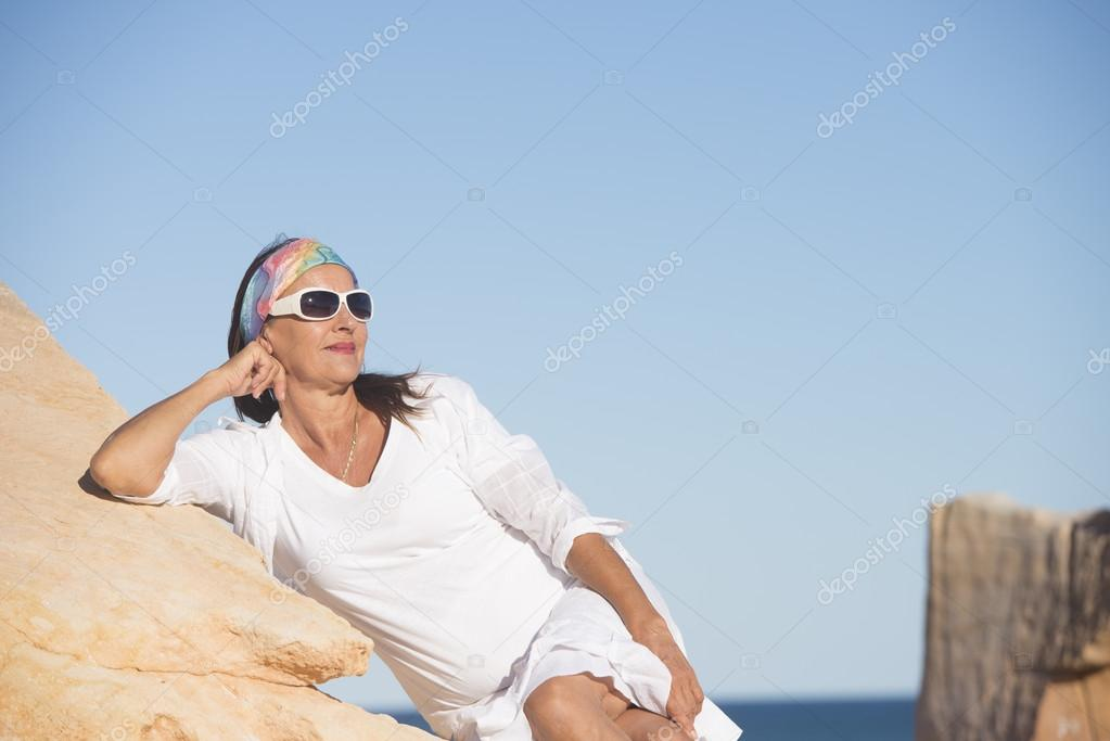 Relaxed confident mature woman at beach