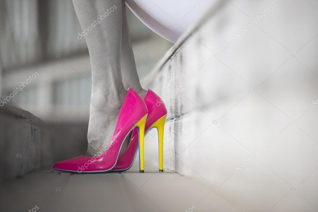 Close up pink high heel shoes woman legs filtered image