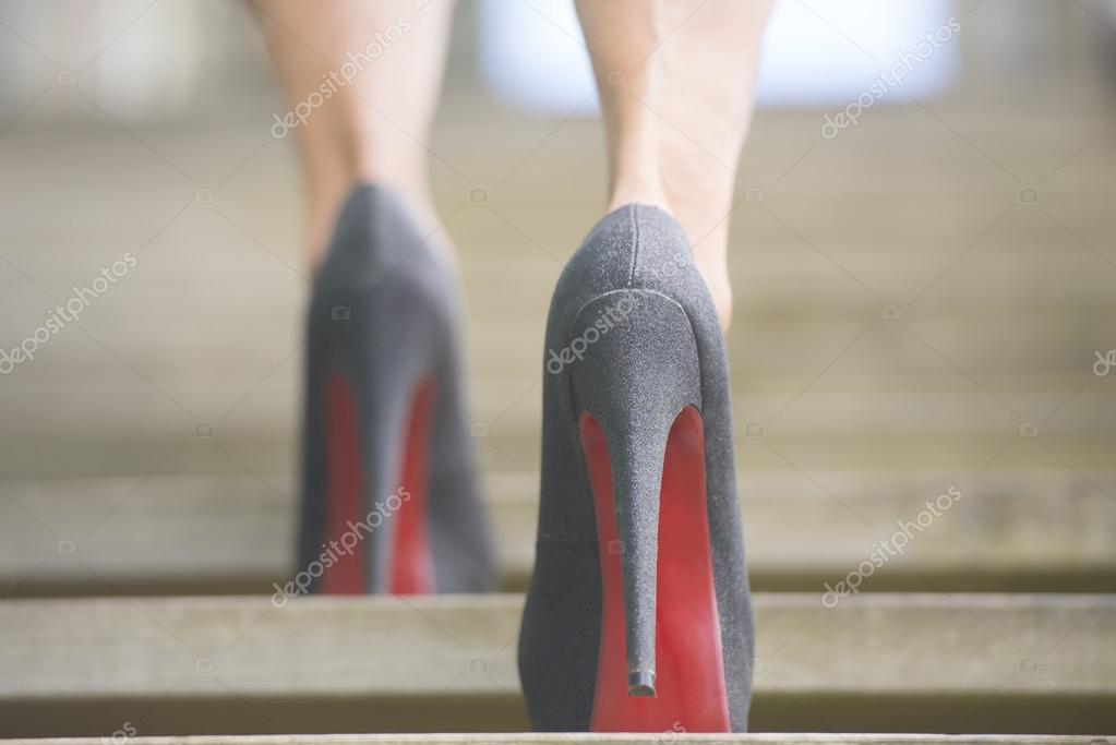 Walking up stairs in high heels