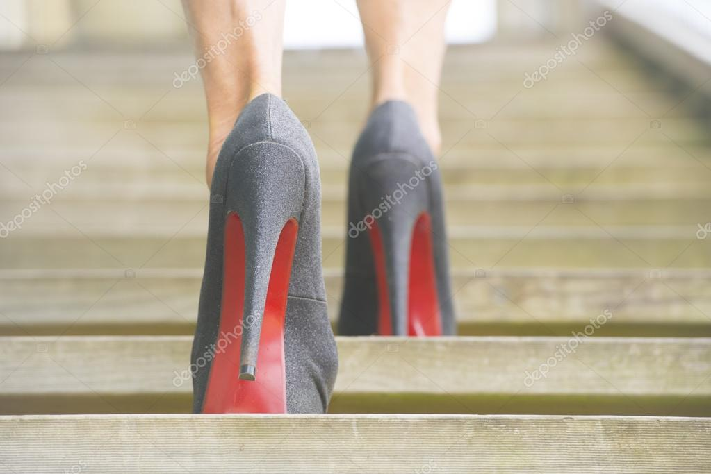 Walking up steps in high heel shoes