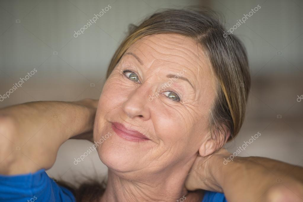 Happy friendly confident senior woman