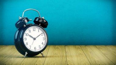Alarm clock on wooden table