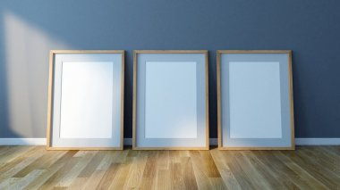 Three Blank picture frames standing on floor. Design Template for Mock Up