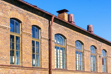 Retro red brick house wall with windows