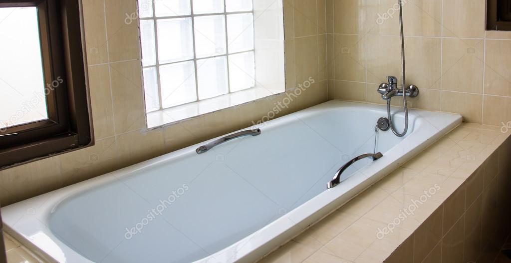 Modern bathtub with tile trim  — Stock Photo © torsak #96742466
