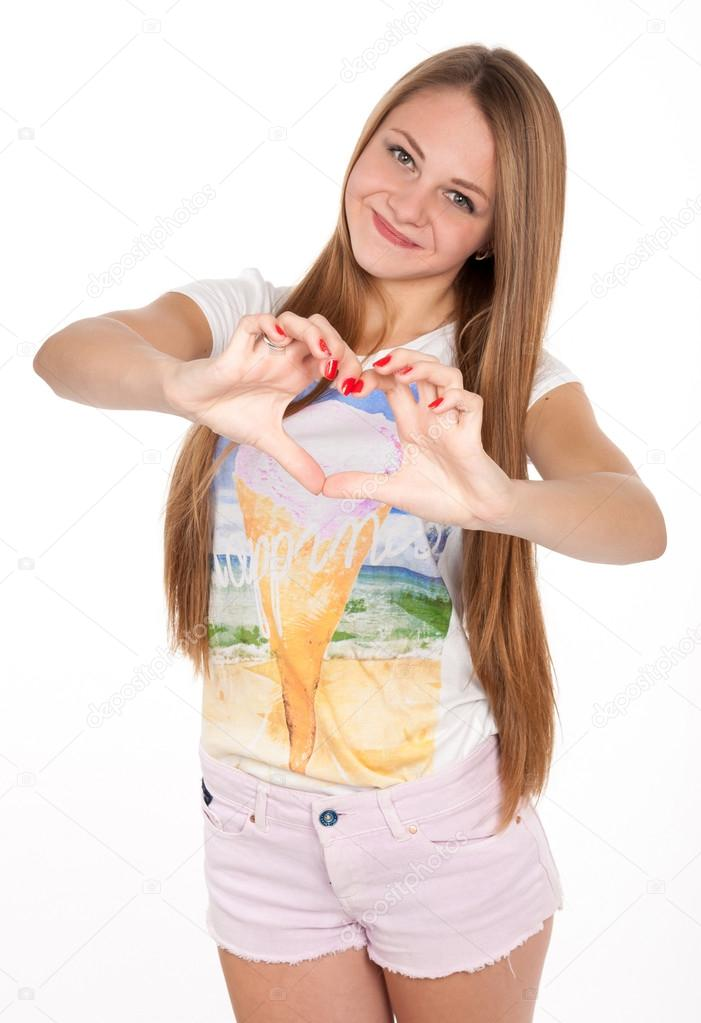 Beautiful Teen Girl Shows A Heart Symbol