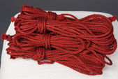 Photo skeins of red ropes for bondage