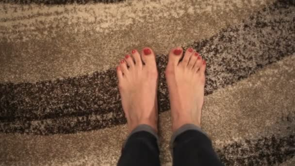 Close-up painted nails and toes with red nail polish