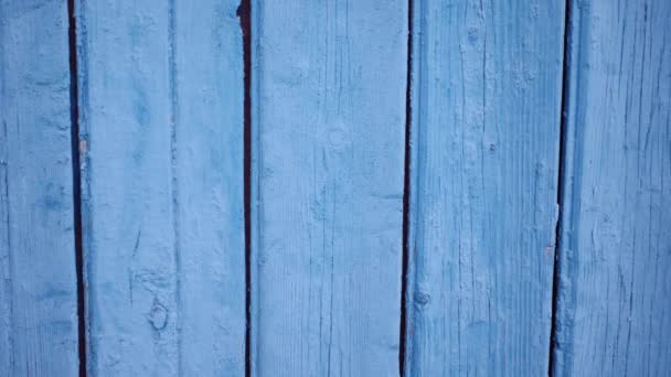 Texture of old wooden turquoise shabby planks with cracks and stains. Abstract background of wooden table top