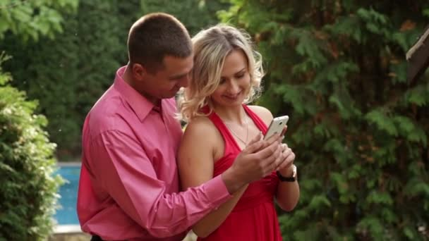 Couple in love in the park with phone