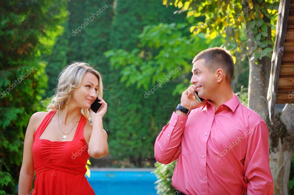 Young couple successful businessmen agree on the best deal. He w