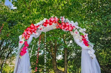 wedding arch with pink flowers orchids