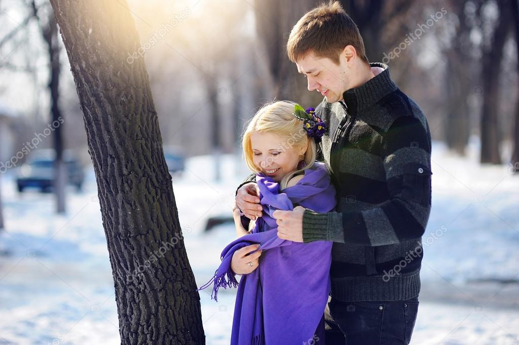 loving couple in the winter man to take care of a woman