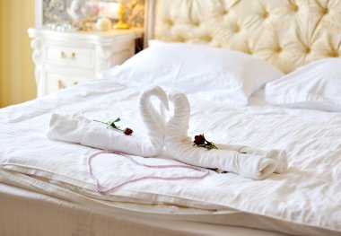 swans out of towels on the bed
