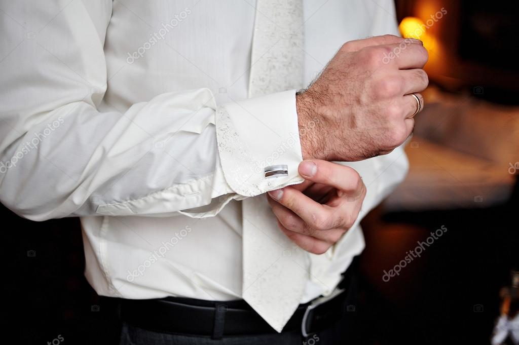 groom wears cufflinks for shirt