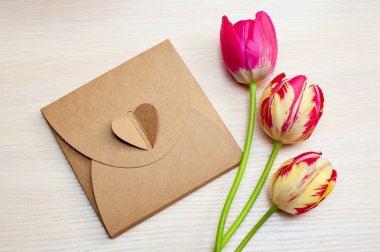 Tulips and boxes with gifts on a white background