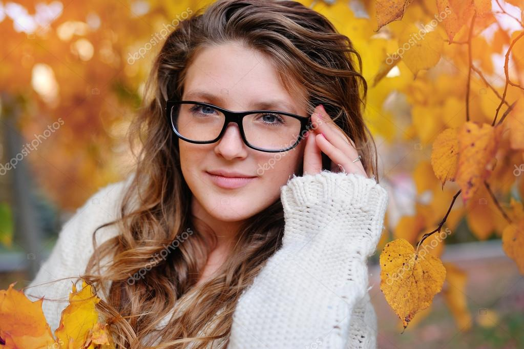 Portrait of beautiful woman wearing fashion glasses during the autumn