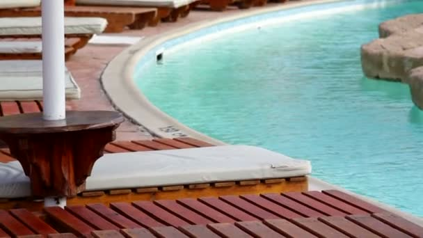 Fragment of nice luxury resort hotel with beautiful swimming pool