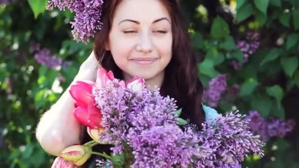 Young woman with lilac wreath. Woman with lilac flowers