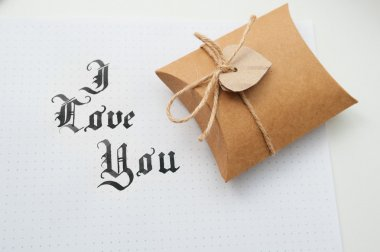 Text god bless you on paper texture and gift box with heart