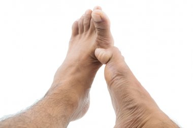 itchy feet uses his big toe to scratch his other foot