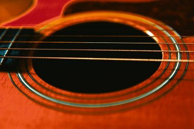Acoustic Guitar Soundhole and Six Strings . Part of wooden guitar