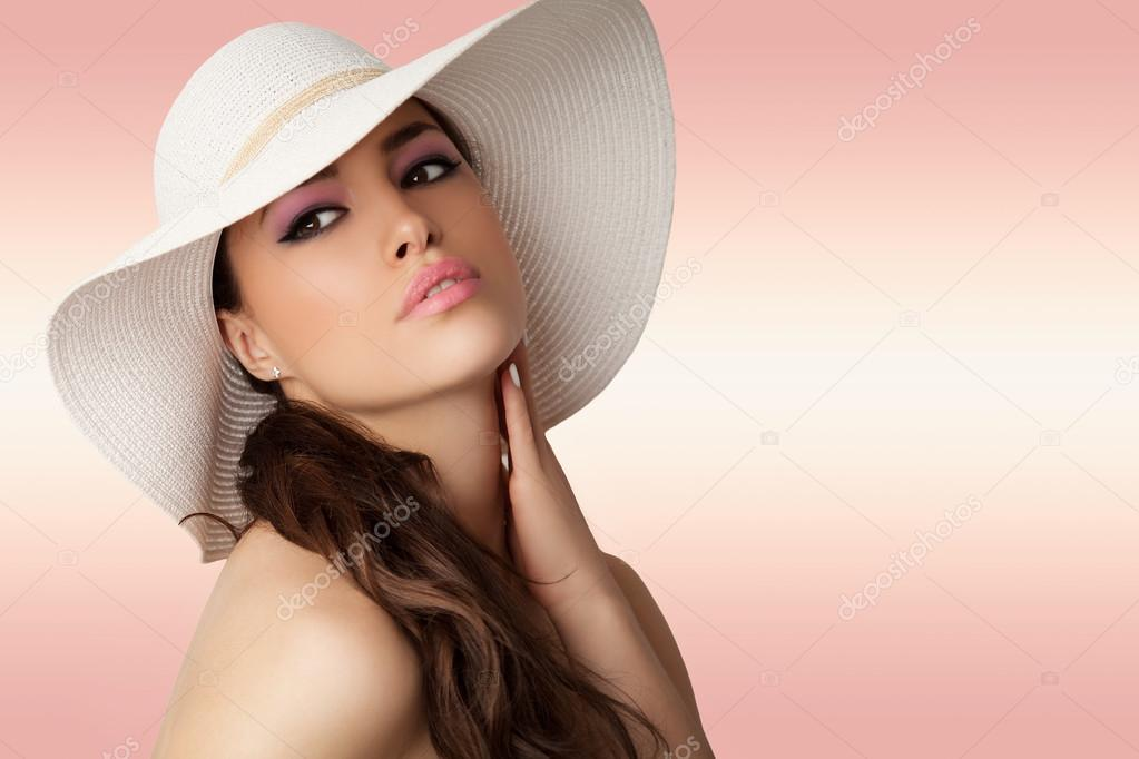 Beautiful young woman wearing white summer hat, studio stock vector