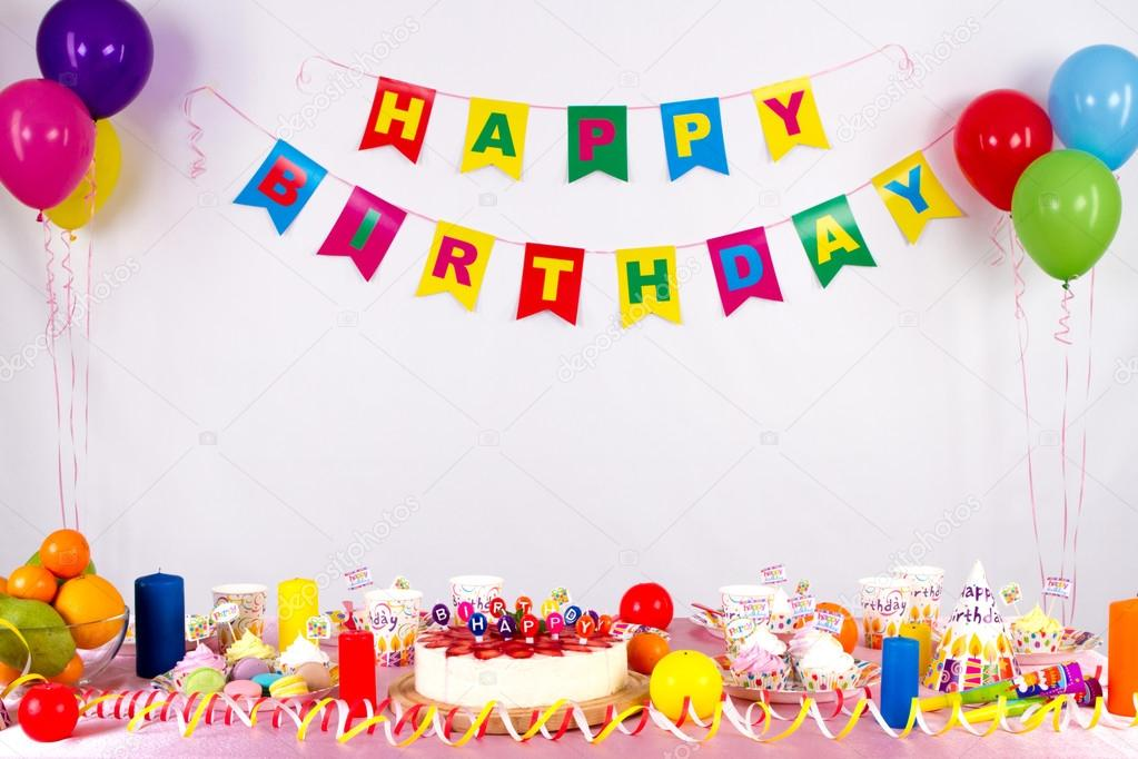 colorful garlands streamer party hats and confetti festive decoration background with sample text
