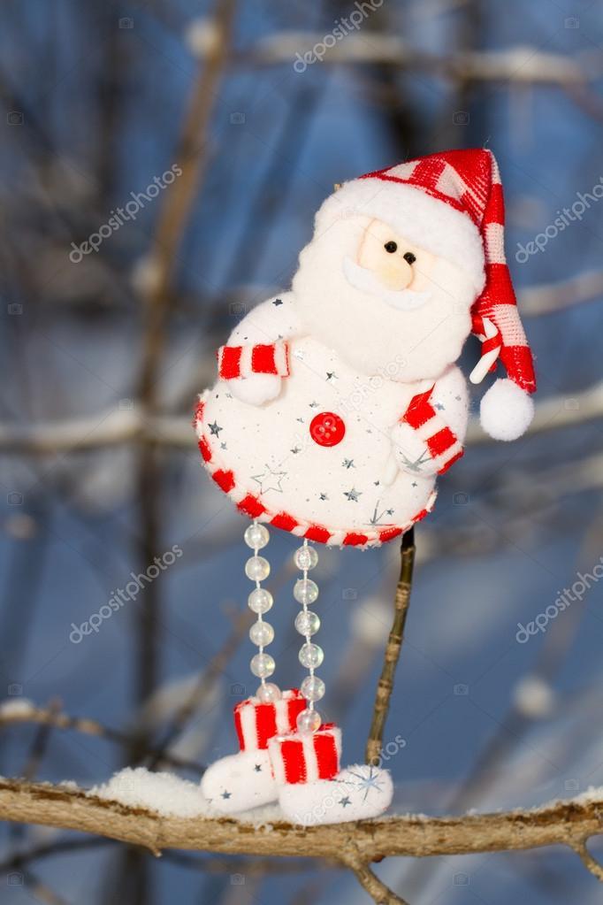 one fun snowman, Santa Claus hanging on a branch