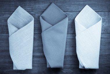 folded napkin on wood