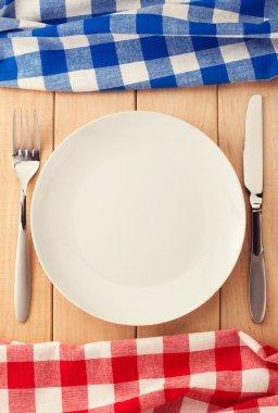kitchen utensils and cloth napkin on wood