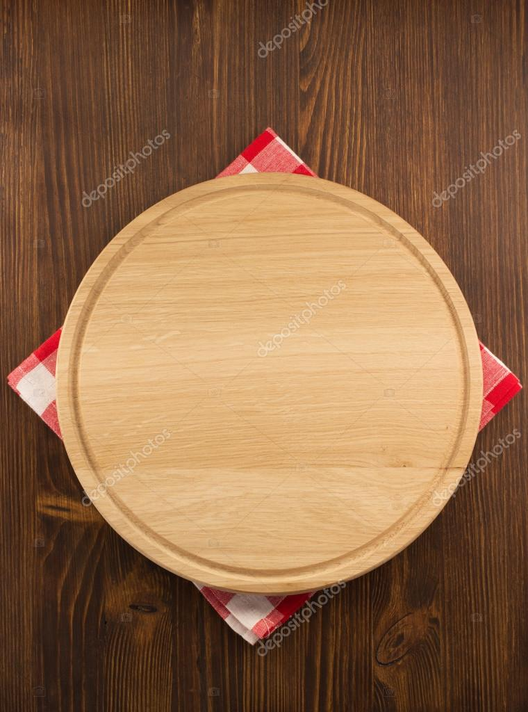 Napkin cloth and cutting board on wood