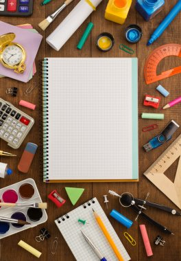 school supplies and notebook on wood
