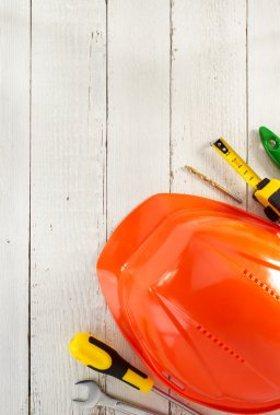 hardhat and tools on wood