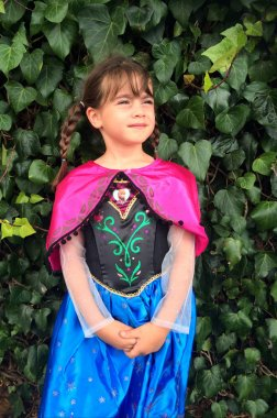 Girl dressed up as Anna the star of the film Frozen in Purim Jewish Holiday