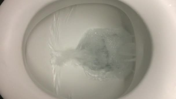 Water flushing in the toilet