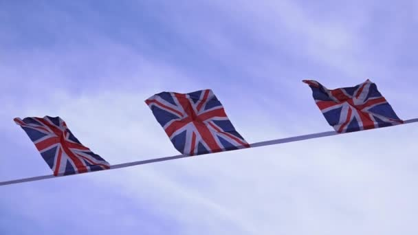 Flags of britain fly in the wind