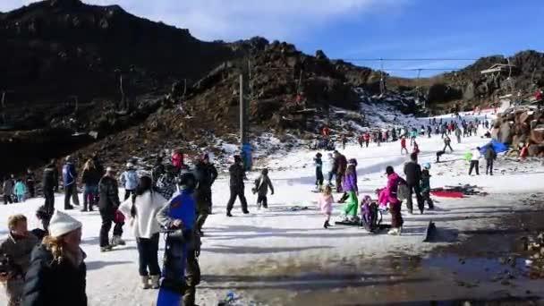 TONGARIRO NATIONAL PARK - JUN 20 2016:Snow skiers in Whakapapa skifield on Mount Ruapehu in Tongariro National Park in the centre of New Zealands North Island