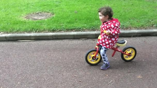 Little girl learn to ride her first bike