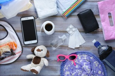 Flat lay view of toddler diaper bag essentials