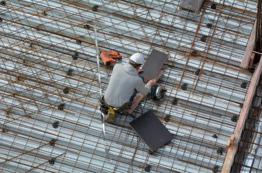 Roofer construction worker works in a construction site