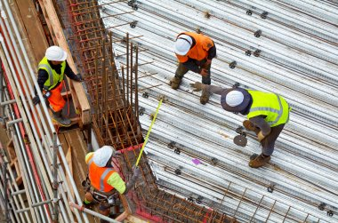 Civil engineer supervise roof construction workers work