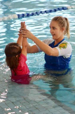 Swimming trainer during swimming pool lesson