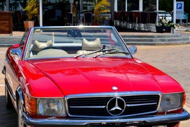 Red Mercedes Benz 560SL
